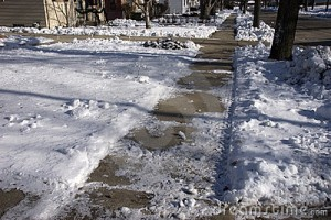 slippery-icy-sidewalk-city-12152438